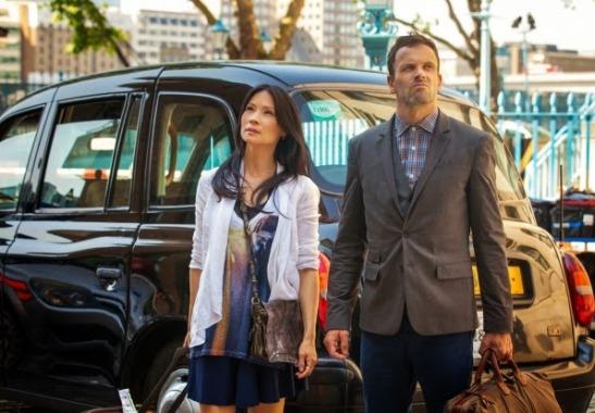 Jonny Lee Miller and Lucy Liu as Sherlock Holmes and Joan Watson in CBS Elementary Season 2 Poster