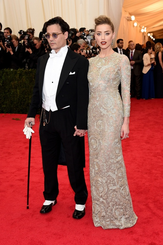 Johnny Depp in Ralph Lauren Black Label and Amber Heard in a Giambattista Valli Haute Couture dress